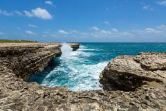 rocky limestone coastline at devil's bridge antigua - stock photo