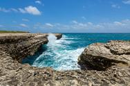 Stock Photo of rocky limestone coastline at devil's bridge antigua