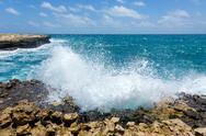 Stock Photo of waves crashing on rocky coastline devil's bridge