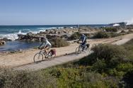 Stock Photo of Spain, Formentera, Mature man and mid adult woman riding bicycle
