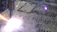 Metal plate is cut with plasma laser cutter. Heavy industry., click for HD Stock Footage