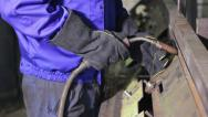 Stock Video Footage of Welding operator welds with torch at welding-site, click for HD