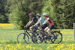 Stock Photo of Germany, Bavaria, Man and women riding bicycle