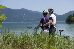 Germany, Bavaria, Man and woman with bike looking at Lake Walchensee Stock Photos