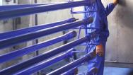Stock Video Footage of Steel iron girders put into heating chamber for painting, click for HD