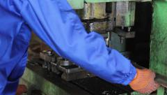 Factory repetitive moves, male stamping holes in iron steel bar, click for HD - stock footage
