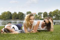 Stock Photo of Germany, Berlin, Young students relaxing at Treptower Park