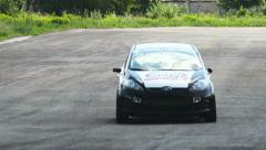 Steering race cars and track tarmac, drivers pass by, click for HD Stock Footage