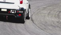 Rubber & traces of sport racing cars on track tarmac, click for HD Stock Footage