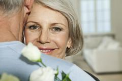 Germany, Berlin, Senior couple embracing, smiling Stock Photos