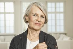 Germany, Berlin, Senior woman with spectacles, portrait - stock photo