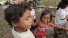 Cambodia Children and School- retrieving rain water from a well - stock footage