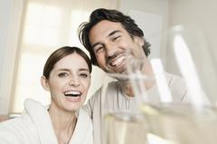 Germany, Berlin, Mature couple in bathroom with sparkling wine Stock Photos
