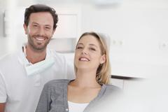 Stock Photo of Germany, Dentist and patient in clinic, smiling