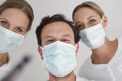 Germany, Dentist with surgical mask, portrait - stock photo