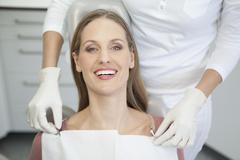 Germany, Patient and dentist in dental office Stock Photos