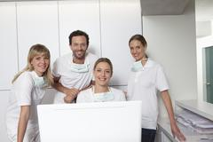 Germany, Dentist and assistance smiling, portrait Stock Photos