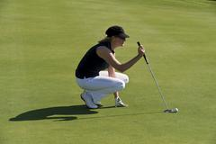 Cyprus, Woman playing golf on golf course - stock photo