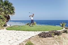 Egypt, Man playing golf on golf course - stock photo