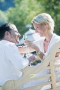 Stock Photo of Austria, Salzburg, Couple drinking champagne