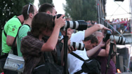 Stock Video Footage of Press correspondents taking photos of event looking at cameras, click for HD