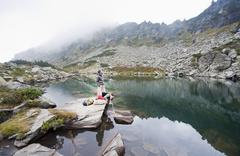 Austria, Styria, Man and woman having rest at Lake Obersee - stock photo
