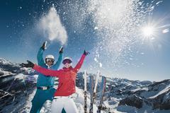 Austria, Salzburg, Young couple standing on top of mountain Stock Photos