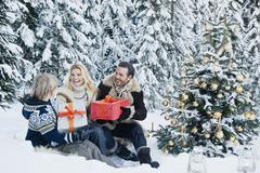 Austria, Salzburg County, Family celebrating christmas in snow - stock photo
