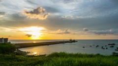 Time lapse photography of sunset view over fishing port. Stock Footage