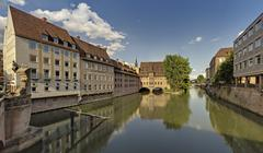 Germany, Bavaria, Nuremberg, View of Heilig Geist Spital with Pegnitz River - stock photo