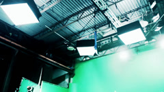 Lighting setup on hollywood green screen sound stage Stock Footage