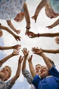 Germany, Bavaria, Group of children raising hands in air Stock Photos