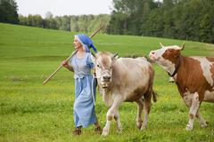 Germany, Bavaria, Mature woman with cow on farm - stock photo