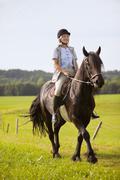 Saksassa, Baijerissa, Aikuinen nainen ratsuna Kuvituskuvat