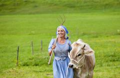 Stock Photo of Germany, Bavaria, Mature woman with cow on farm