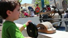 Kid Turning wheel Stock Footage