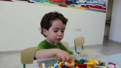 Boy Plays with Game Bricks - stock footage