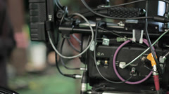 professional red camera on dolly tracks - stock footage