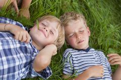 Stock Photo of Germany, Bavaria, Boys lying in meadow