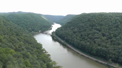 Scenic overlook with river, railroad tracks, & bridge Stock Footage