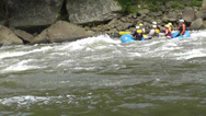 Stock Video Footage of whitewater rafters side view