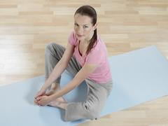 Young woman limbering up, portrait Stock Photos