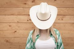 Germany, Teenage girl covering face with cowboy hat Stock Photos