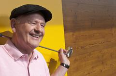 Germany, North Rhine Westphalia, Duesseldorf, Golfer on golf course, smiling Stock Photos
