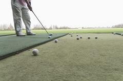 Germany, North Rhine Westphalia, Duesseldorf, Golfer playing golf Stock Photos