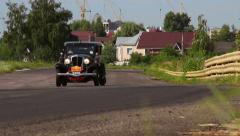 Classic black old film-looking car Rockne Six 75 Studebaker, click for HD Stock Footage