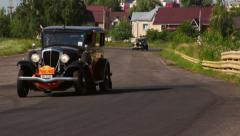 Nice shot of several retro vintage cars on driveway, click for HD Stock Footage