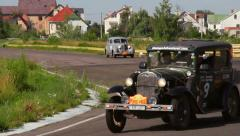 Ford Model A and Packard Six, Peking to Paris rally, click for HD - stock footage