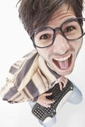 Young man with crazy glasses and keyboard, portrait Stock Photos