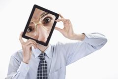 Stock Photo of Businessman with tablet pc, portrait